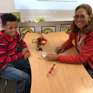 GEM Students Solder Remote Operated Vehicles