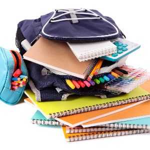 IMAGE: Backpack filled with school supplies.