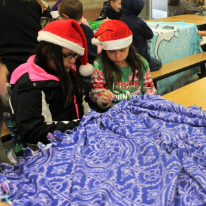 IMAGE: Students making blankets.