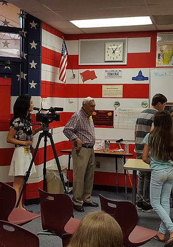 Reporter interviews WWII veteran speaking to students