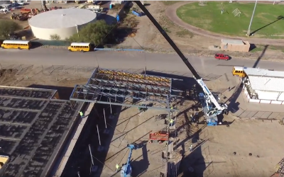 IMAGE: Steel rafters being placed by crane on roof of new transportation center.