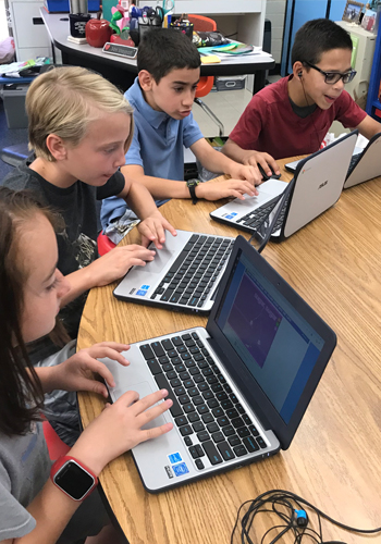 Students at Butterfield ELementary working on Chromebook computers