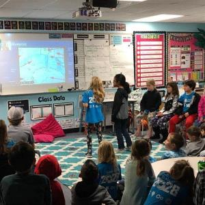 IMAGE: 3rd Graders Presenting Penguin Exhibits to Reid Park via Skype.