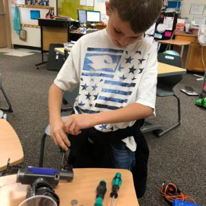 IMAGE: 3rd Grade GEM Student with Dyson Engineering Box