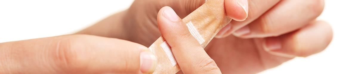 Bandaid being placed on finger