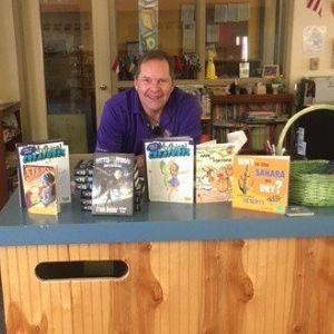 THe Marana Host Lions CLub with books on counter