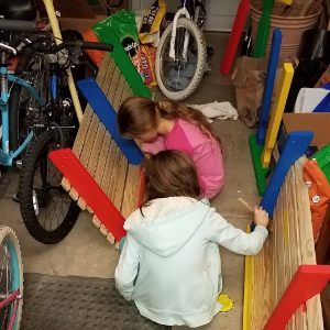 IMAGE: Charlotte and Rebecca Turner during the construction process of the friendship bench.