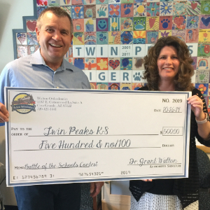 IMAGE: Principal Doni Luce accepting $500 Award check from Walton Orthodontics.