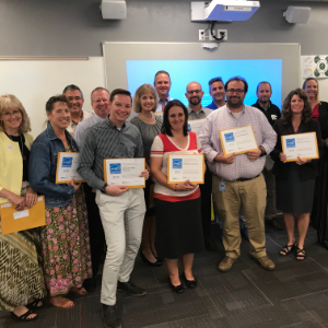 MUSD Principals display Energy Award Certificates following presentation