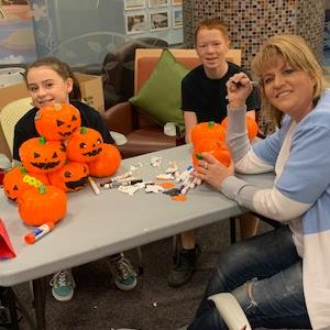 IMAGE:  Marana Middle School's Associate Principal Ms. Barr and Students decorate pumpkins.