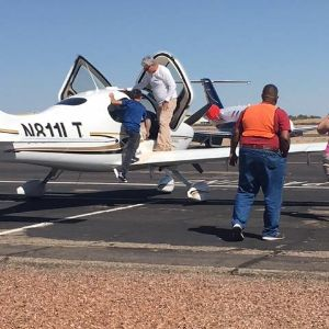 DeGrazia student boards plane to begin flight