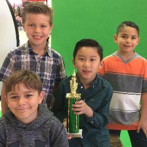 Christian  Yepiz, Caleb Larcom, Noah Hart, and Vincent Nguyen with chess trophy