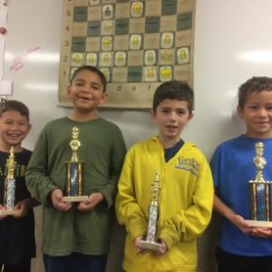 IMAGE: DeGrazia Elementary School's Chess Team display trophies.
