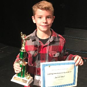 Jacob Hart, DeGrazia Elementary School, 5th grade displays trophy and certificate