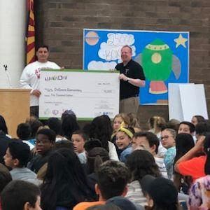 Lee Schutt, DeGrazia Elementary Teacher receives $5,000 Grant Check