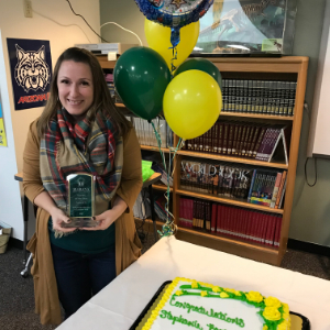 IMAGE: Stephanie (Cohn) Barger with award, cake and balloons during Teacher of the Year presentation.