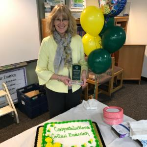 IMAGE:  IMAGE: Colleen Frederick, MUSD Administrator of the Year with Award, Cake and Balloons during presentation.