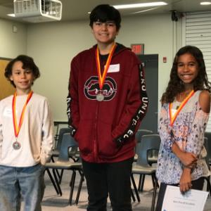 Top 3 RRE Spelling Bee Winners left to right: Josiah Livingston, Andrew Wical, Alexi Powell Escalan