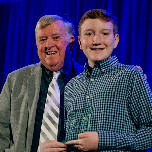 IMAGE: Jacob Cox receiving 2019 Youth Legacy Award from Mayor Honea.