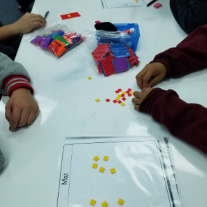 IMAGE: Students learning with algebra tiles, a hands on approach to learning.