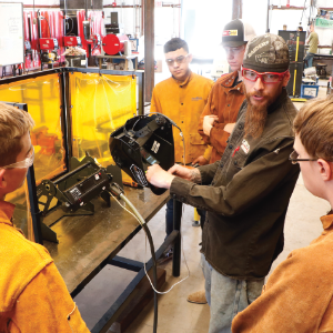 IMAGE: Welding Instructor Kenton Webb explains live training welding booth to students.