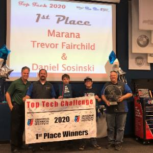 IMAGE: Trevor Fairchild and Daniel Sosinski on stage receiving 1st place at Top Tech Challenge.