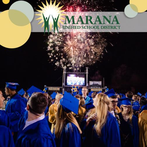 Marana High School graduates watching fireworks over stage and field