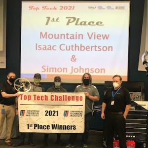 Simon Johnson & Isaac Cuthbertson, on stage placing 1st in the UTI Top Tech Challenge
