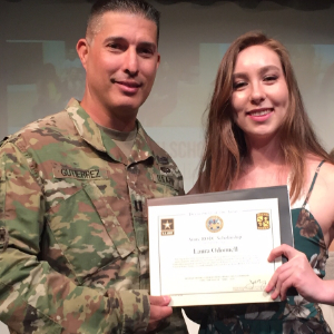 IMAGE: Laura O'Donnell presented with the Army ROTC Scholarship.