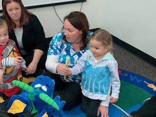 IMAGE: MCAT Dental Students teaching preschoolers about dental hygiene in the classroom.