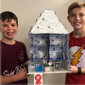 IMAGE: Students display winning house model project.
