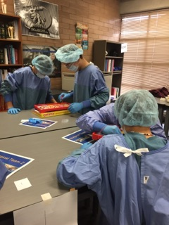 IMAGE: Students at Elevate dressed in medical apparel.