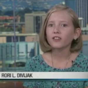 IMAGE: Rori L. Divijak reporting on Bear Essential News TV.