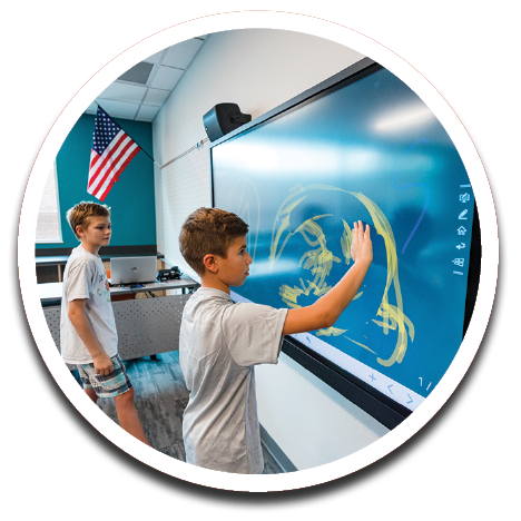 IMAGE: Students with touchscreen.