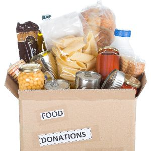 IMAGE: Food donations in a box.