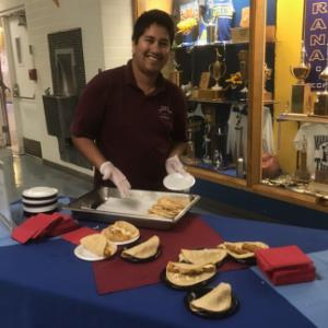 IMAGE: MUSD cafeteria staff prepare and distribute fish tacos for student taste test.