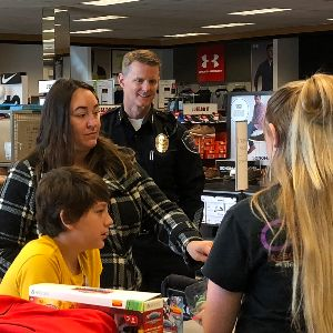 Marana police officer shopping at Kohl's with MUSD student.