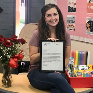 Lindsey Shotwell with roses, certificate and school supplies