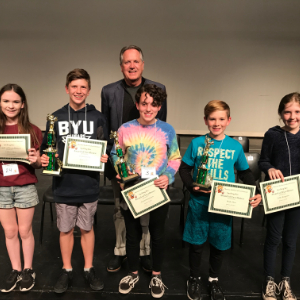 IMAGE: Top 5 winners of District Spelling Bee with Superintendent Wilson.