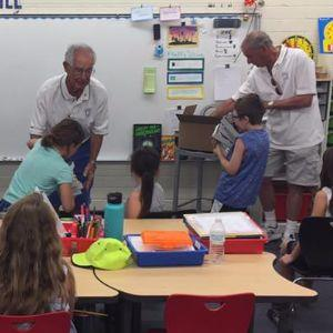Dove Mountain Rotary Club distribute dictionaries to Butterfield students.