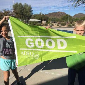 "IMAGE: Students holding ""Good"" Green ADEQ Flag."