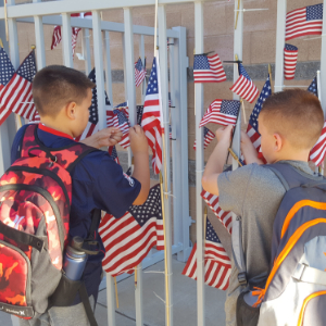 Students hanging flags for Patriot Day