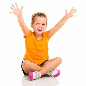 Young girl with arms outstretched in happiness