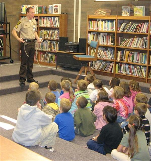 Students learning from Deputy