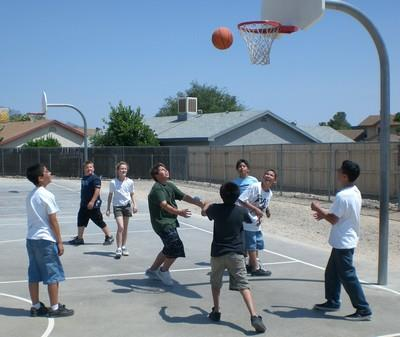 Students participating in a game of basketball