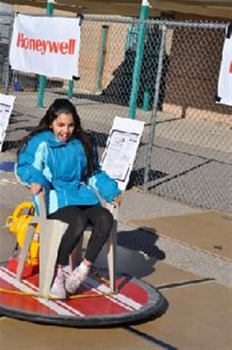 Student riding hovercraft at Science Fair