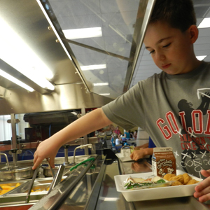 IMAGE: Student with lunch tray serving.