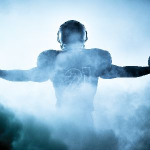 Football player in fog at night